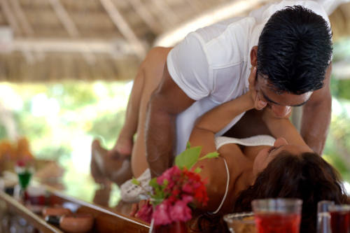 Passionate couple lying on bar
